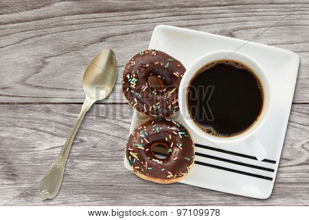 Mini Doughnut With Chocolate And Sprinkles Cup Of Coffee Breakfast