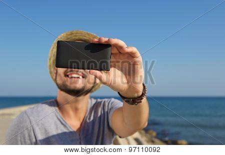 Smiling Man Taking Selfie At The Beach