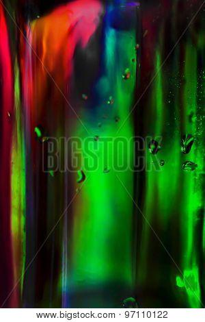 Water Drops On Dark Green Glass Bottle