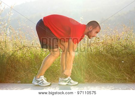 Sports Man Adjusting His Shoe Before Running Exercise