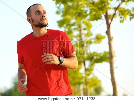 Young Man Enjoying A Run Outdoors