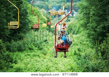 Tourist Going On Cable Car Funicular