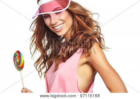Beauty summer model girl Eating colourful lollipop.
