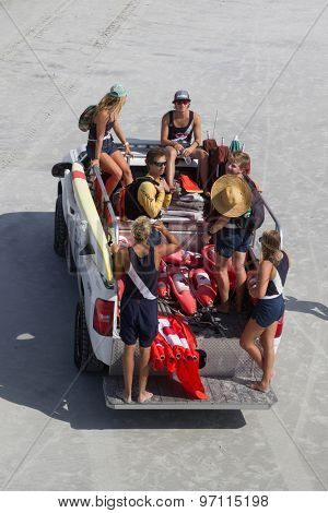 JACKSONVILLE BEACH, FL, USA - JULY 26, 2015: A group of Jacksonville Beach Lifeguards beginning their day by being transported to their stations along 4.1 miles of coastline at Jacksonville Beach.