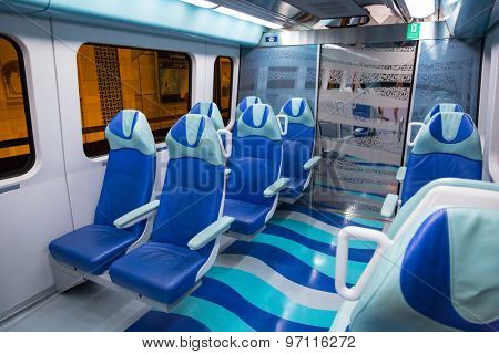 DUBAI, UAE - 31 MARCH 2014: Metro line interior in Dubai, UAE. The Dubai Metro is a driverless, fully automated metro rail network in the city of Dubai and carry over 180,000 passengers every day.