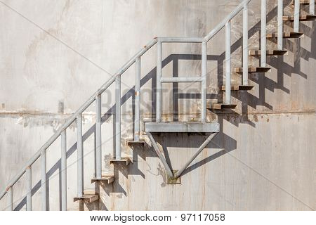 The Stairway On Exterior Of Refinery Industrial Storage Tank.
