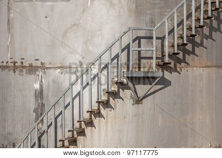 Closeup Exterior Stairs Of Refinery Industrial Storage Tank.