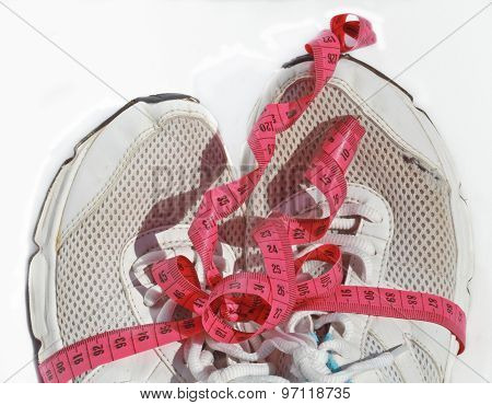 shabby elder training shoes with measuring tape like a gift, a l