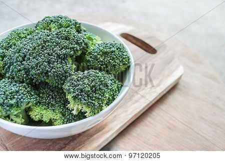 Fresh Broccoli Vegetable In White Bowl On Wooden Table