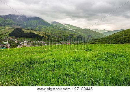 Village Near Meadow In Mountains