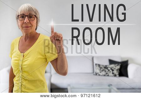 Living Room Touchscreen Is Shown By Senior
