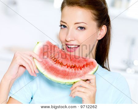 Woman Eats A Red Water-melon