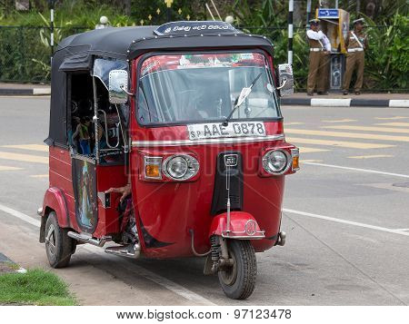 Auto rickshaw or tuk-tuk on the street of Matara. Sri Lanka