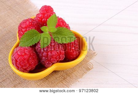 Fresh Raspberries And Lemon Balm On White Wooden Table, Healthy Food