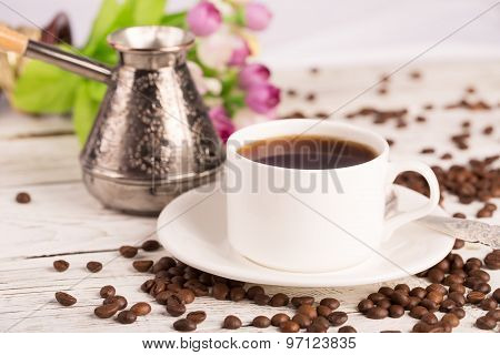 Coffee Pot, Cup And Scattered Coffee