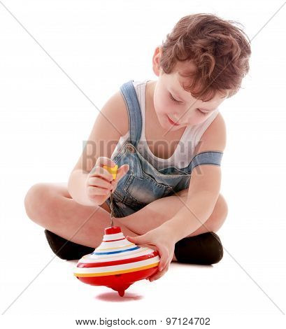 Boy playing with a spinning top