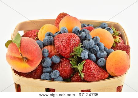 Strawberries, Apricots, Blueberries, Peach In Basket Isolated On White