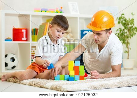kid boy and father play builders