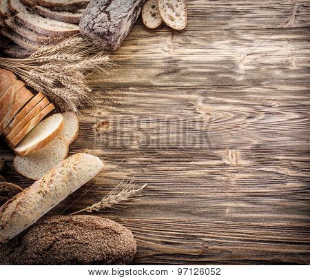 The bread and a wheat on the wooden desk.