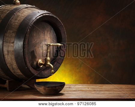 Old oak wine barrel on wooden table.