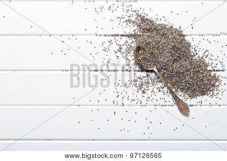 chia seeds in spoon on white table