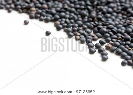 Beluga. Black lentil on white background.