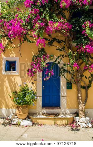 Traditional Greek House With Flowers In Assos, Kefalonia Island, Greece.