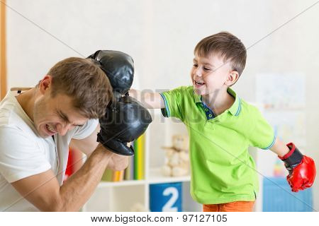 child and dad play boxing
