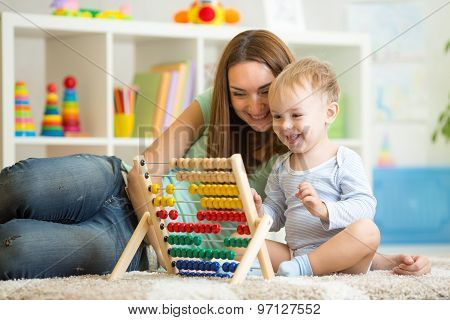 kid playing with abacus