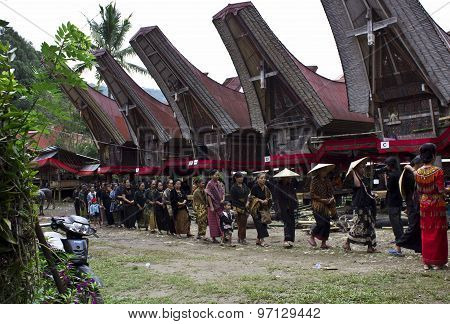 People Procession At A Traditional Funeral Ceremony