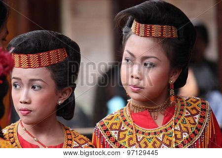 Two Torajan Girls Traditionally Dressed