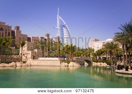 DUBAI, UAE - 1 APRIL 2014: View for Burj Al Arab hotel from the Madinat Jumeirah in Dubai, UAE. Burj Al Arab with 321 meters high is the most luxurious 7 star hotel and a symbol of modern Dubai.