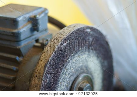 Closeup of bench grinder old wheel