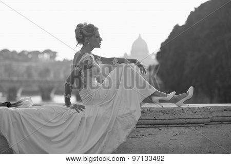 Sensual Bride Sitting On Bridge