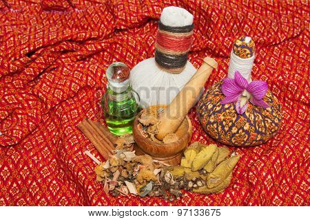 Thai Spa Massage Setting With Thai  Herbal Compress Balls, Essential Oil Bottle, Towel