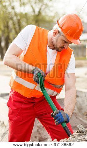 Construction Worker In Orange Waistcoat