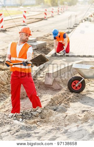 Construction Workers Building New Road