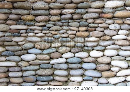Photo of the wall exactly paved with stones