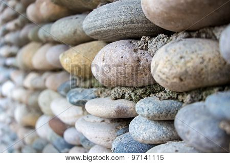 Image wall exactly paved with colourful stones