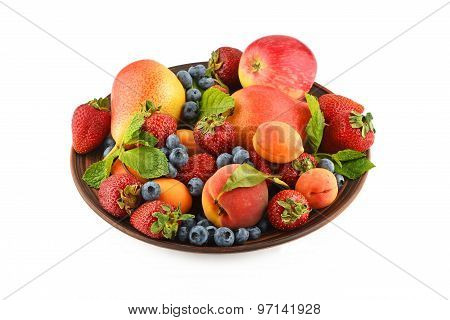 Fruits And Berries Mix In Ceramic Plate Isolated On White