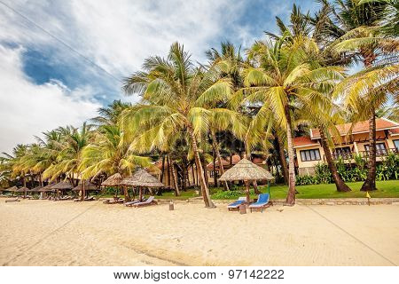 Beautiful tropical beach with  palms near small resort at Phu Quoc island  in Vietnam.