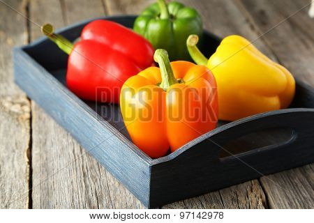 Fresh and tasty pepper on grey background
