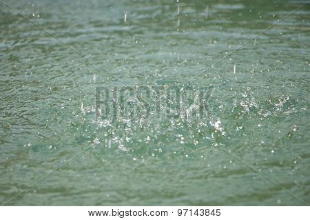 Image splashes on the turquoise water ripples
