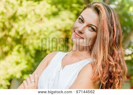 young happy woman on natural green background, smiling happy girl outdoor portrait