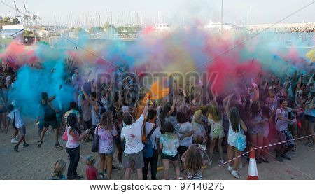 People Dancing In Colored War Event, Larnaca, Cyprus