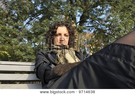 Melancholy young women sitting on a bench