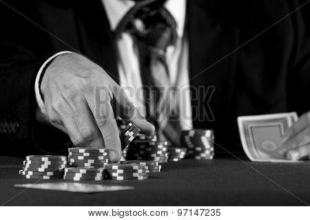 Man Betting On The Casino In Black And White