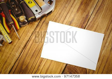 White card against desk with tools