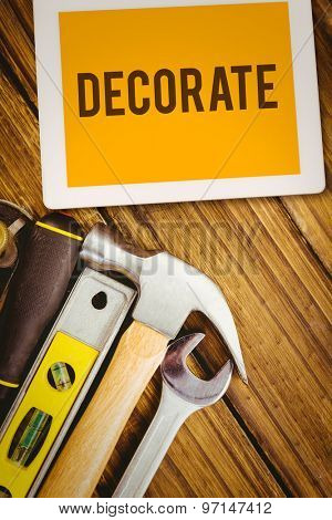 The word decorate and tablet pc against desk with tools
