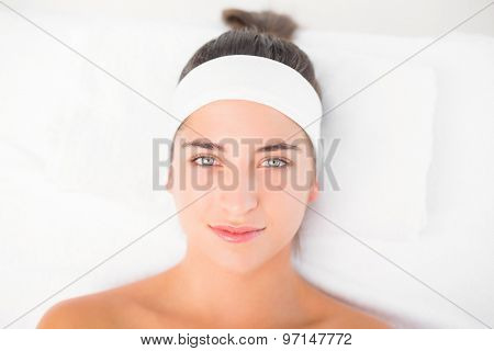 Beautiful young woman on a massage table at spa center